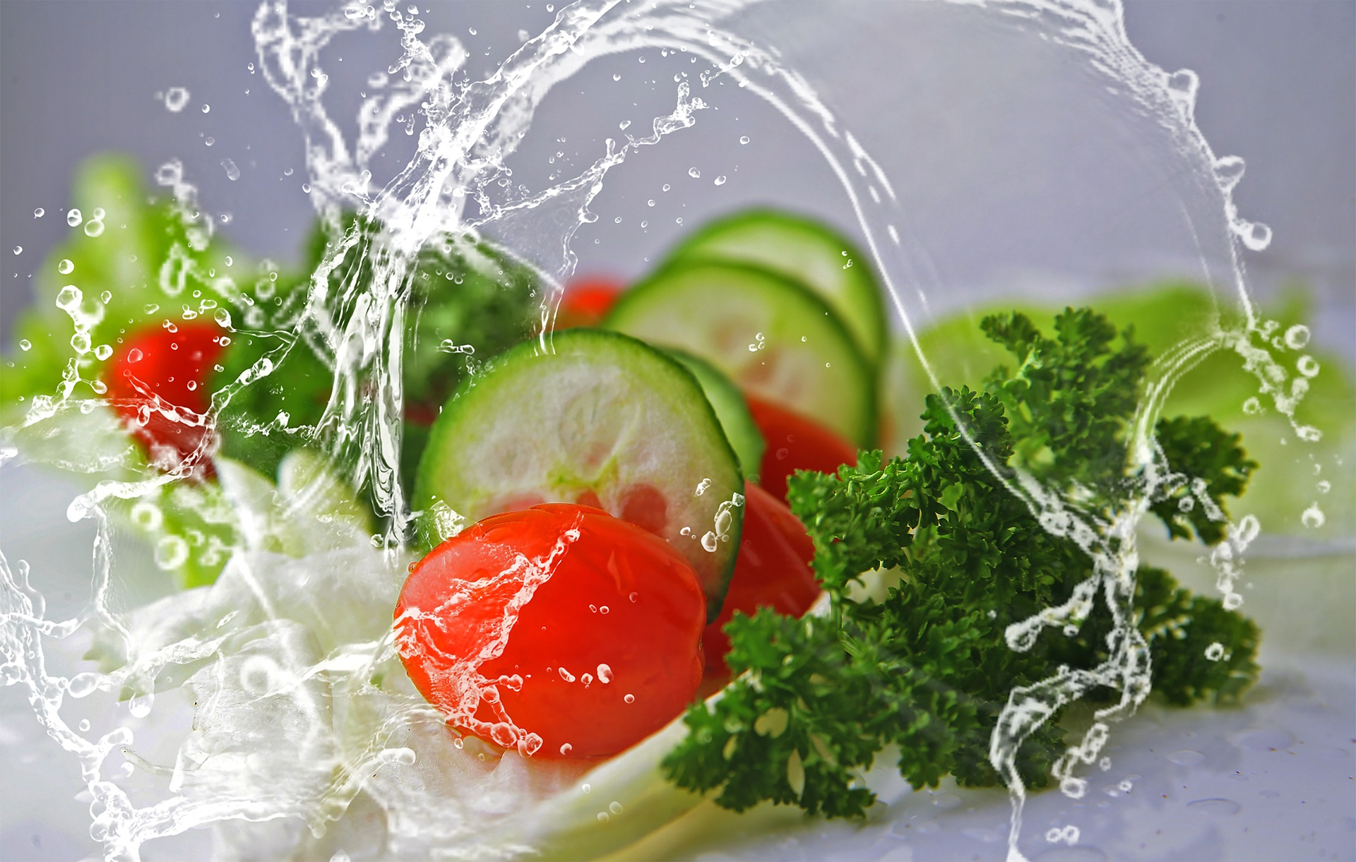 Image of health foods including cucumber, tomato, lettuce and water
